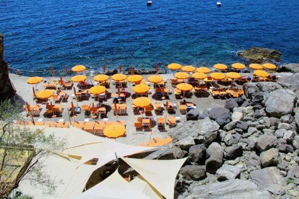 beach with yellow umbrellas in Praiano